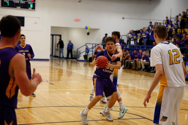 Kirtland Central's Jacoby Love maintains possession after nearly losing the ball against Bloomfield during a district basketball game on Feb. 13 at Bobcat Gym. The Broncos open the new season Nov. 29 at Los Lunas.