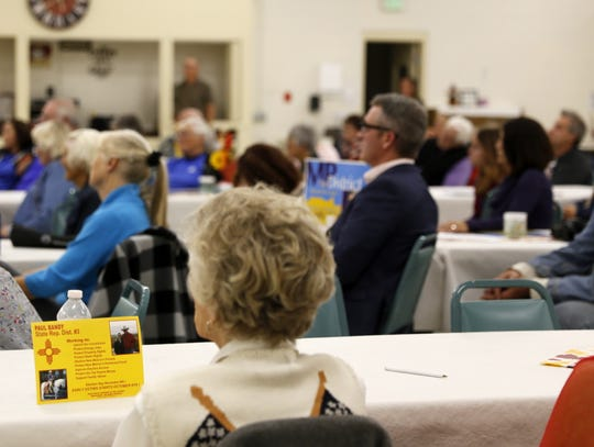 Audience members listen Tuesday in Aztec during a candidate forum for the District 3 state House seat.