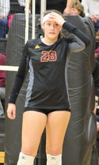 Mercy's sophomore setter Julia Bishop (28) prepares to set up the Marlins offense against Marian.