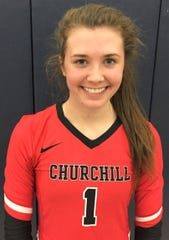 Grace Vaeth was all smiles after her Livonia Churchill volleyball team captured the KLAA East Division title.