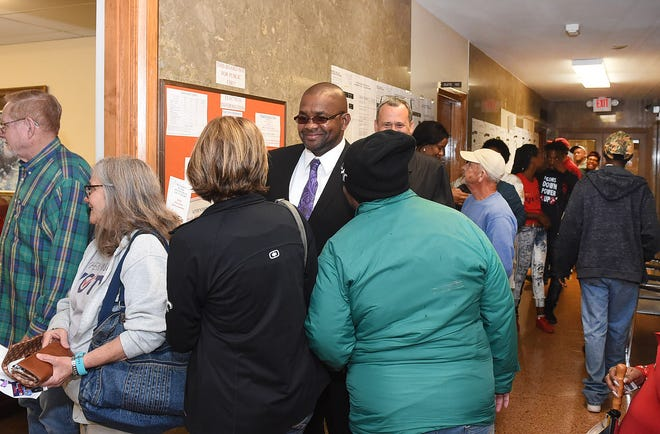 A long line forms outside the St. Landry Parish Registrar of Voters office as early voters cast their votes on the first day of early voting in St. Landry Parish.