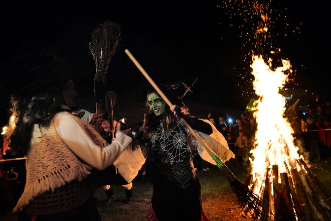 Locals dressed as witches dance around the fire on April 30, 2014 at Stiege, Germany. In the past, women who used plants to heal were labeled as witches due to their independence and ability to help ailing people.