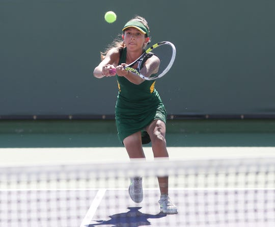 Maritssa Nolasco of Coachella Valley returns a shot during her doubles match against Indio in the DVL semifinals at the Indian Wells Tennis Garden, October 23, 2018.