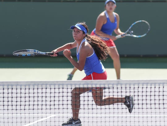 Maria Carmona, left, and Abril Parra of Indio during their semifinals doubles match against Coachella Valley, October 23, 2018.