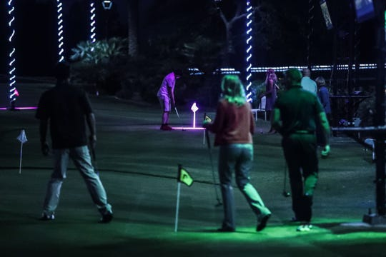 "Projectors project different putting games on practice greens at Indian Wells Golf Resort on Wednesday, October 17, 2018 during ""Shot in the Night."""