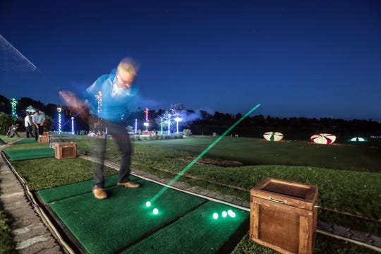 """Jerry Upham, of Palm Desert, hits a glowing ball at glowing targets at the Indian Wells Golf Resort on Wednesday, October 17, 2018 during """"Shot in the Night."""""""