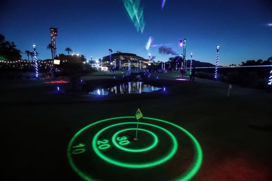 """Projectors project different putting games on practice greens at Indian Wells Golf Resort on Wednesday, October 17, 2018 during """"Shot in the Night."""""""