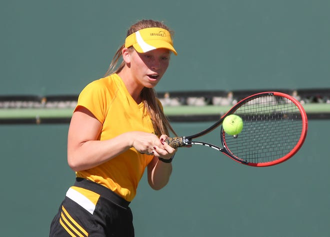 Katie Brattain of Yucca Valley hits a shot during her match against Laricza Navarro of Indio during DVL singles semifinal match against  at the Indian Wells Tennis Garden, October 23, 2018.