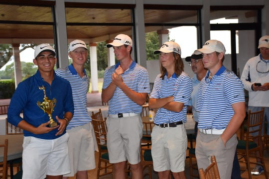 The Pace High boys golf team, led by medalist John David Cobb (holding trophy) after winning Monday's Region 1-2A golf championship at Tiger Point