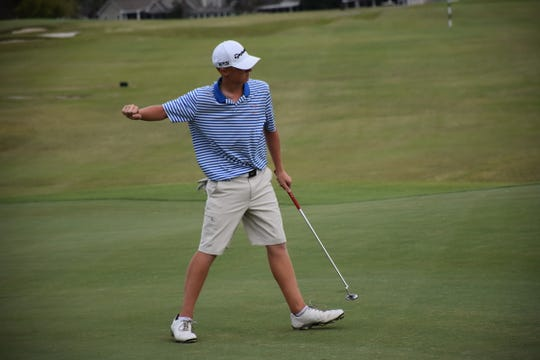 Pace High's Ethan Hansen reacts after sinking putt on No. 18 during the sudden-death playoff against Mosley in the Region 1-2A golf championship.