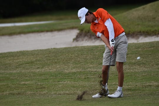 Mosley's Will Massey hits his approach shot into No. 1 on the first sudden-death playoff hole at Monday's Region 1-2A golf championship.
