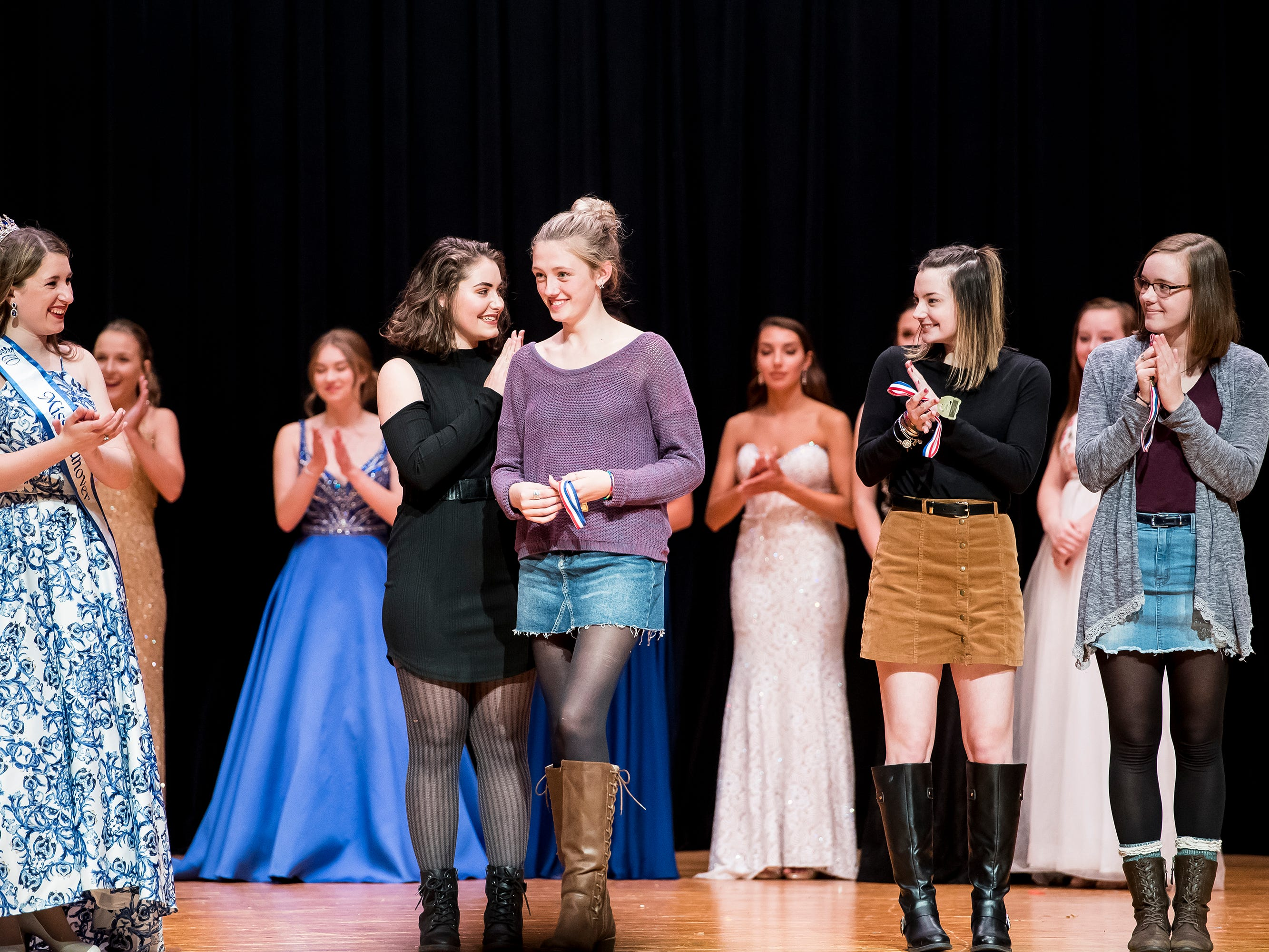 Anna Holden, third from left, reacts a she is named the winner of the junior essay award at the 50th Miss Hanover Area pageant on Monday, October 22, 2018 at New Oxford High School.