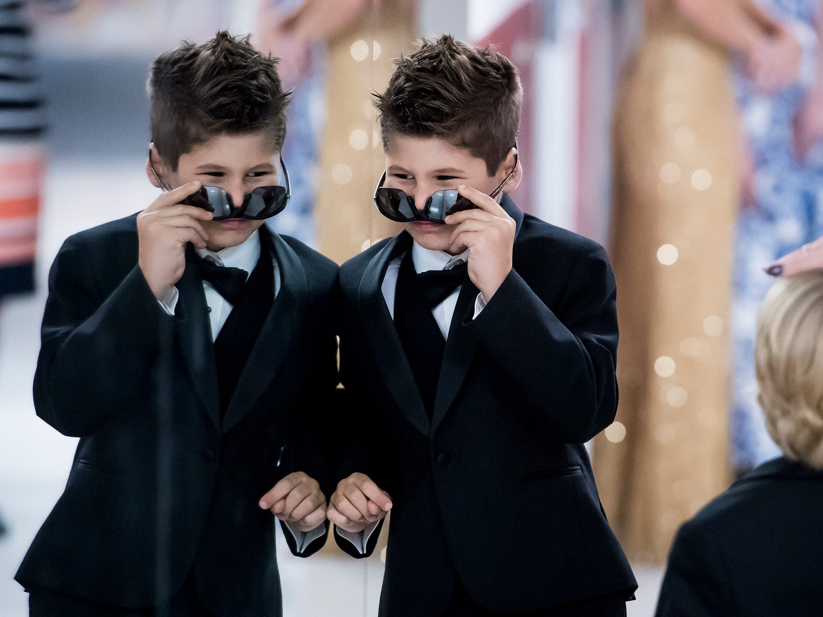 Liam Colvin, 6, checks out his sunglasses in a mirror during the intermission at the 50th Miss Hanover Area pageant on Monday, October 22, 2018.
