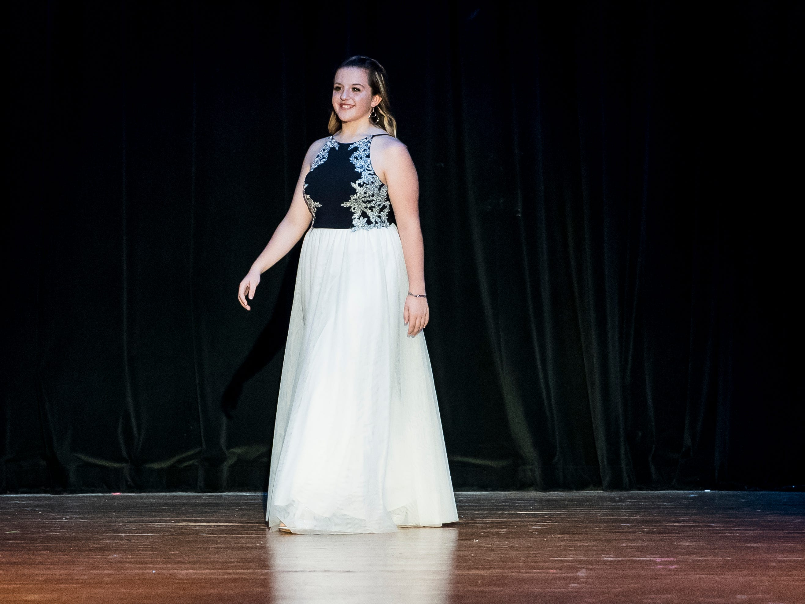 Mackenzie Buckley walks on stage during the evening gown competition in the 50th Miss Hanover Area pageant on Monday, October 22, 2018.