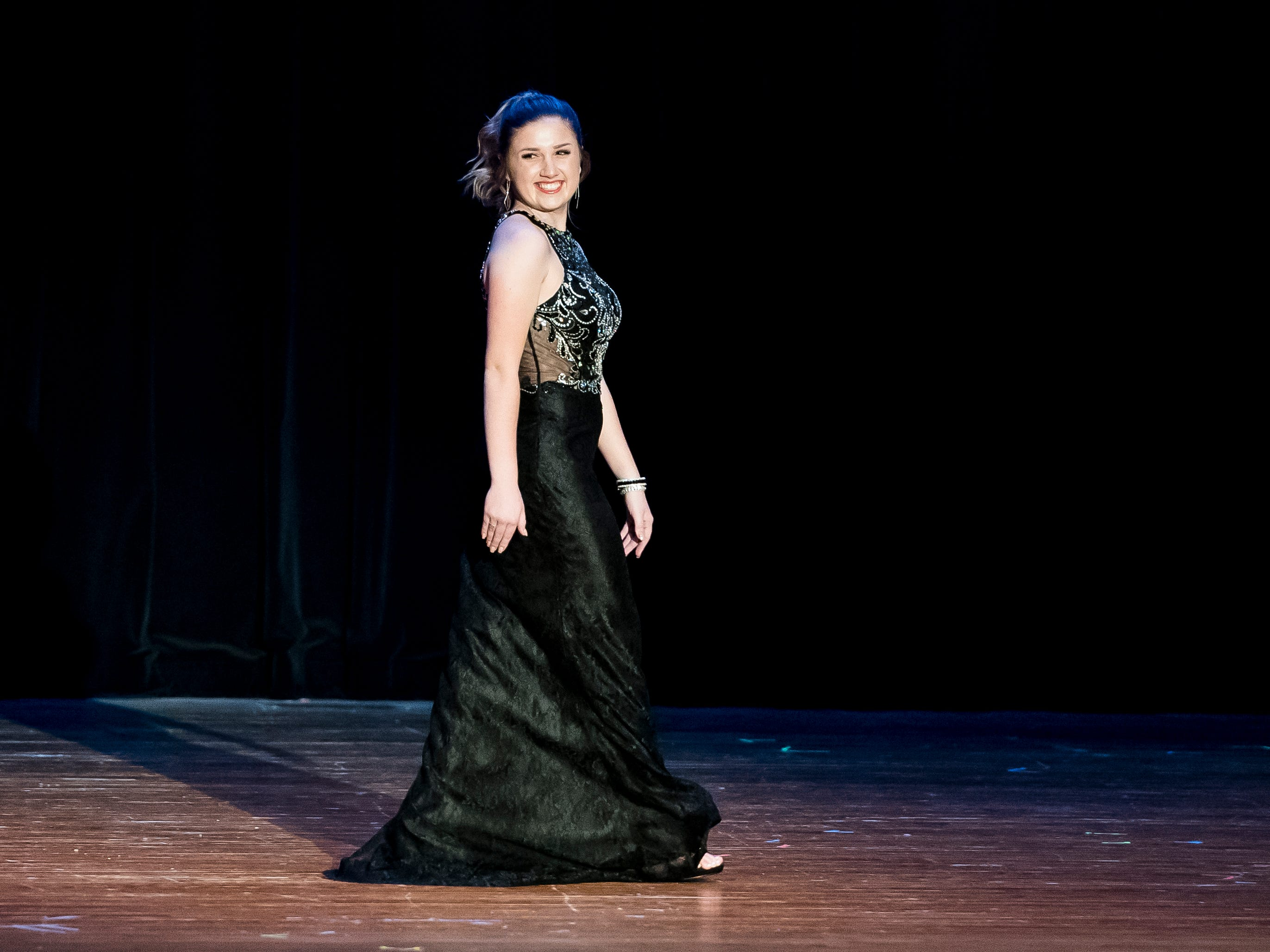 Hannah Nell walks on stage during the evening gown competition in the 50th Miss Hanover Area pageant on Monday, October 22, 2018.
