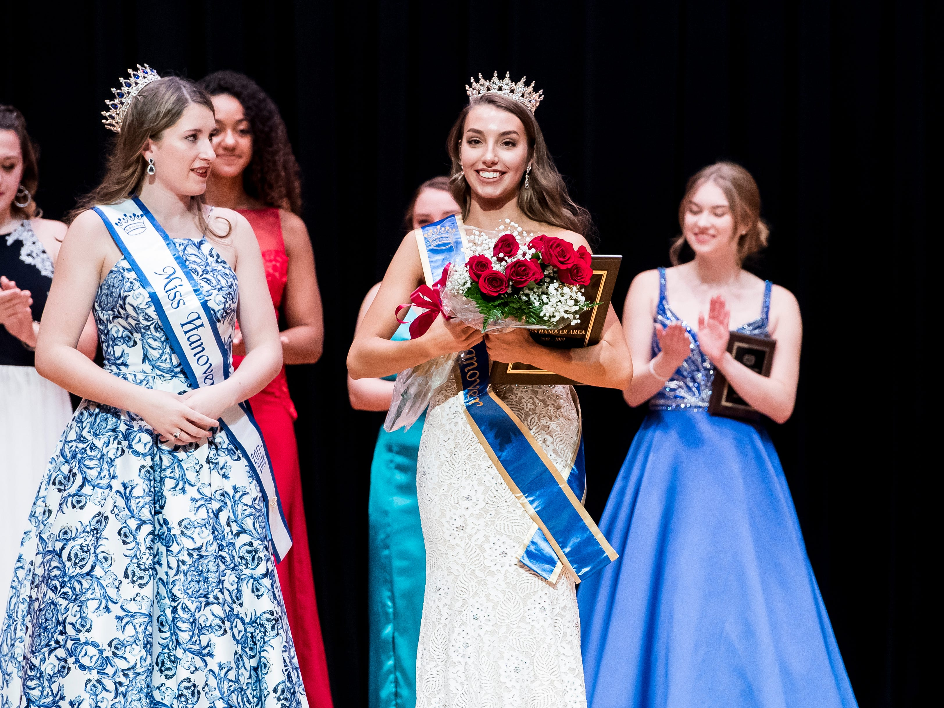 South Western's Madlyn Farley, right, smiles on stage after being crowned the 50th Miss Hanover Area on Monday, October 22, 2018.