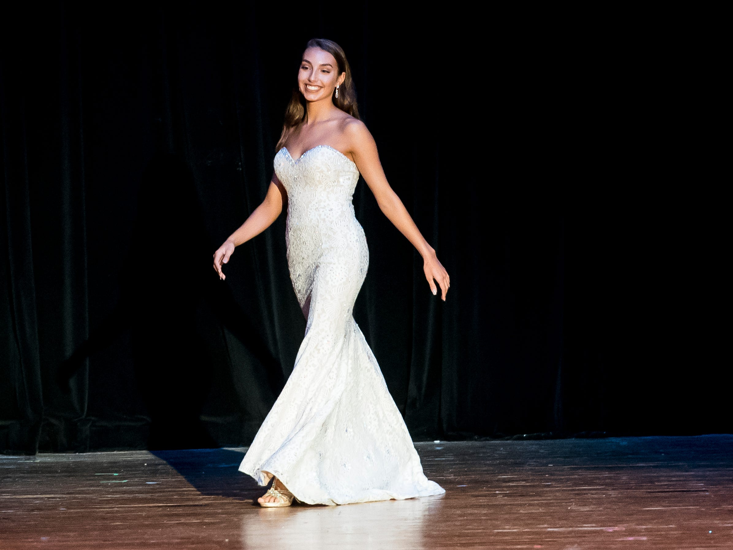 Madlyn Farley walks on stage during the evening gown competition in the 50th Miss Hanover Area pageant on Monday, October 22, 2018.