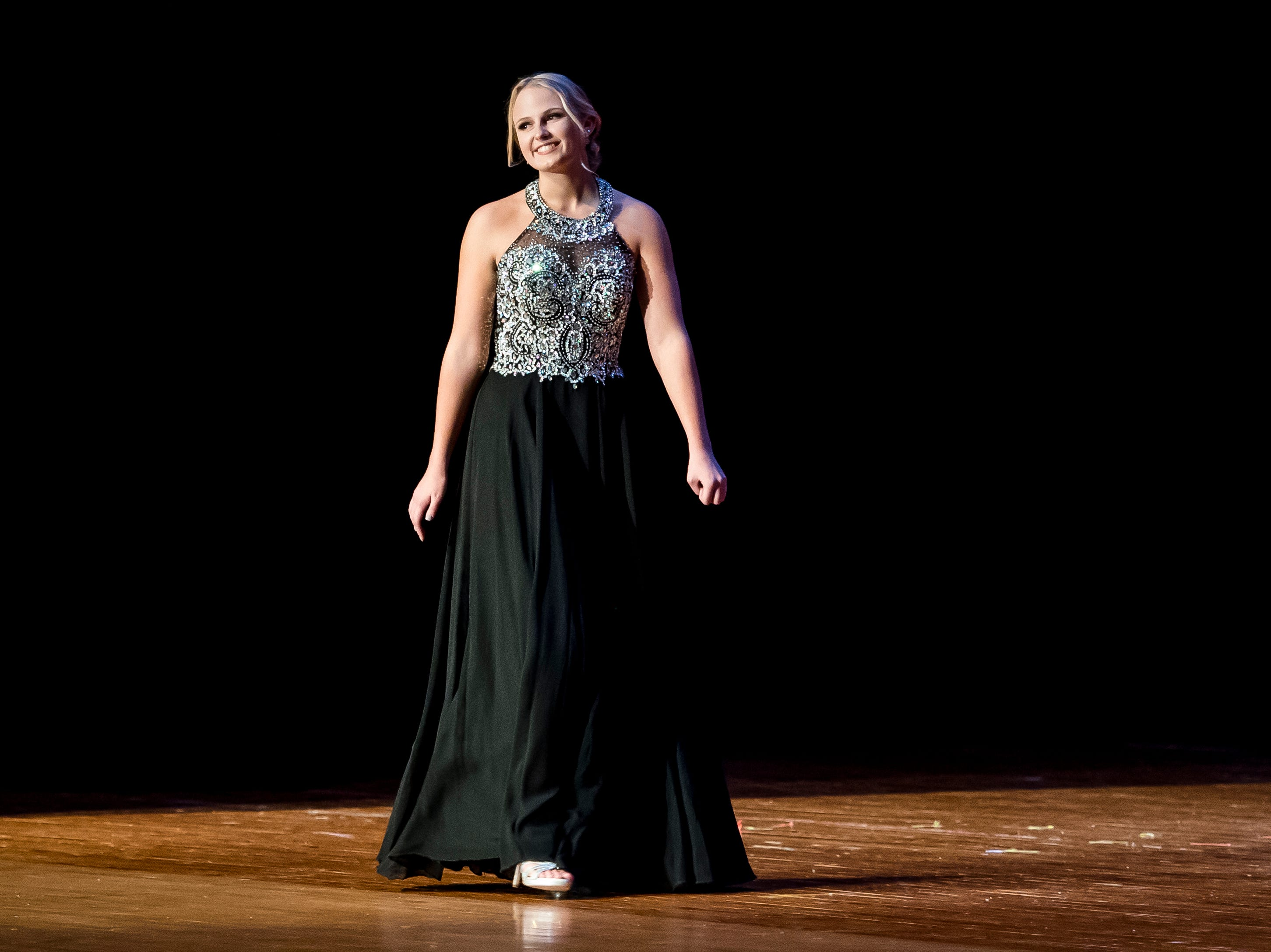 Cara Green walks on stage during the evening gown competition in the 50th Miss Hanover Area pageant on Monday, October 22, 2018.