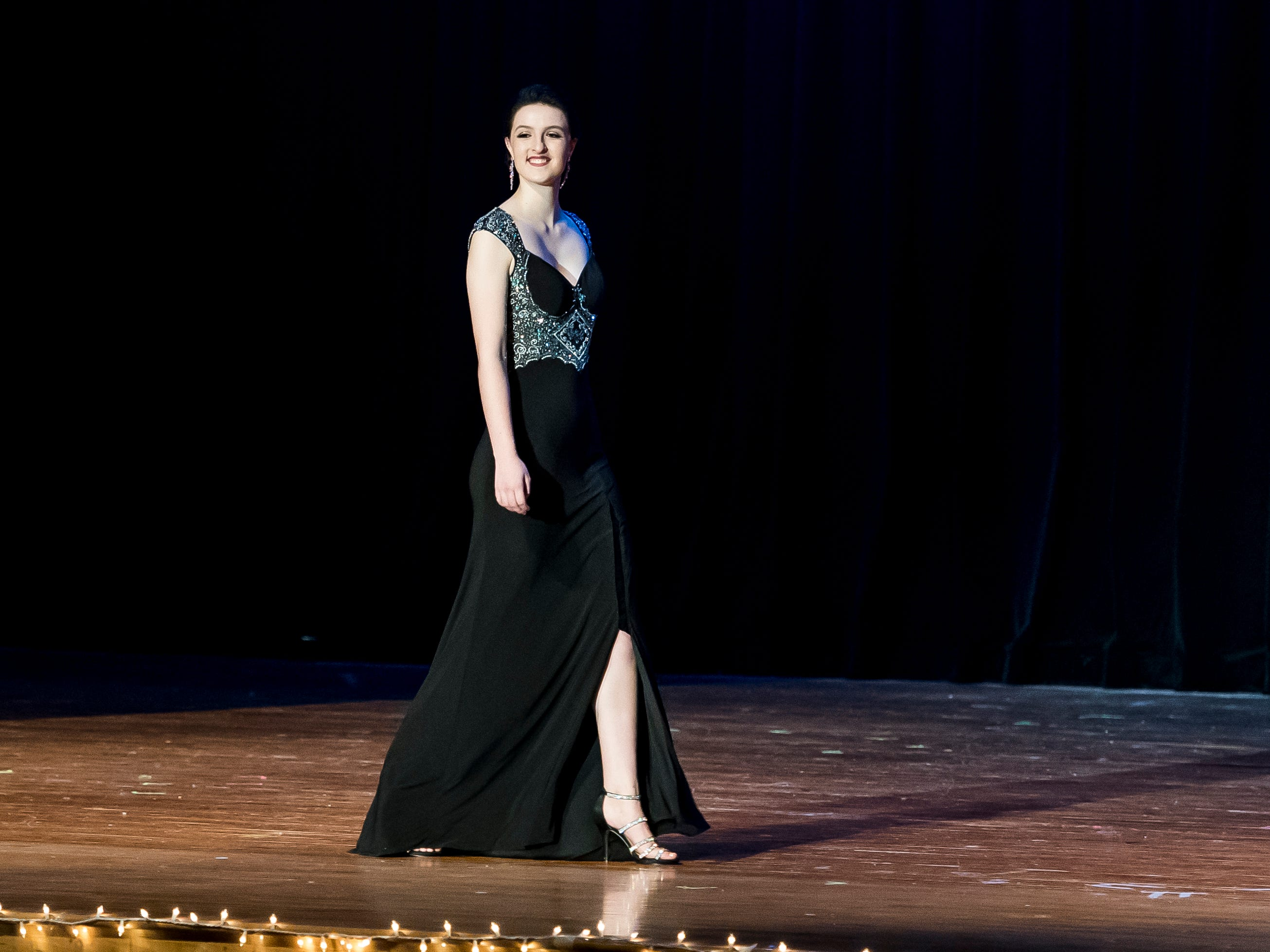 Hannah Uhl walks on stage during the evening gown competition in the 50th Miss Hanover Area pageant on Monday, October 22, 2018.