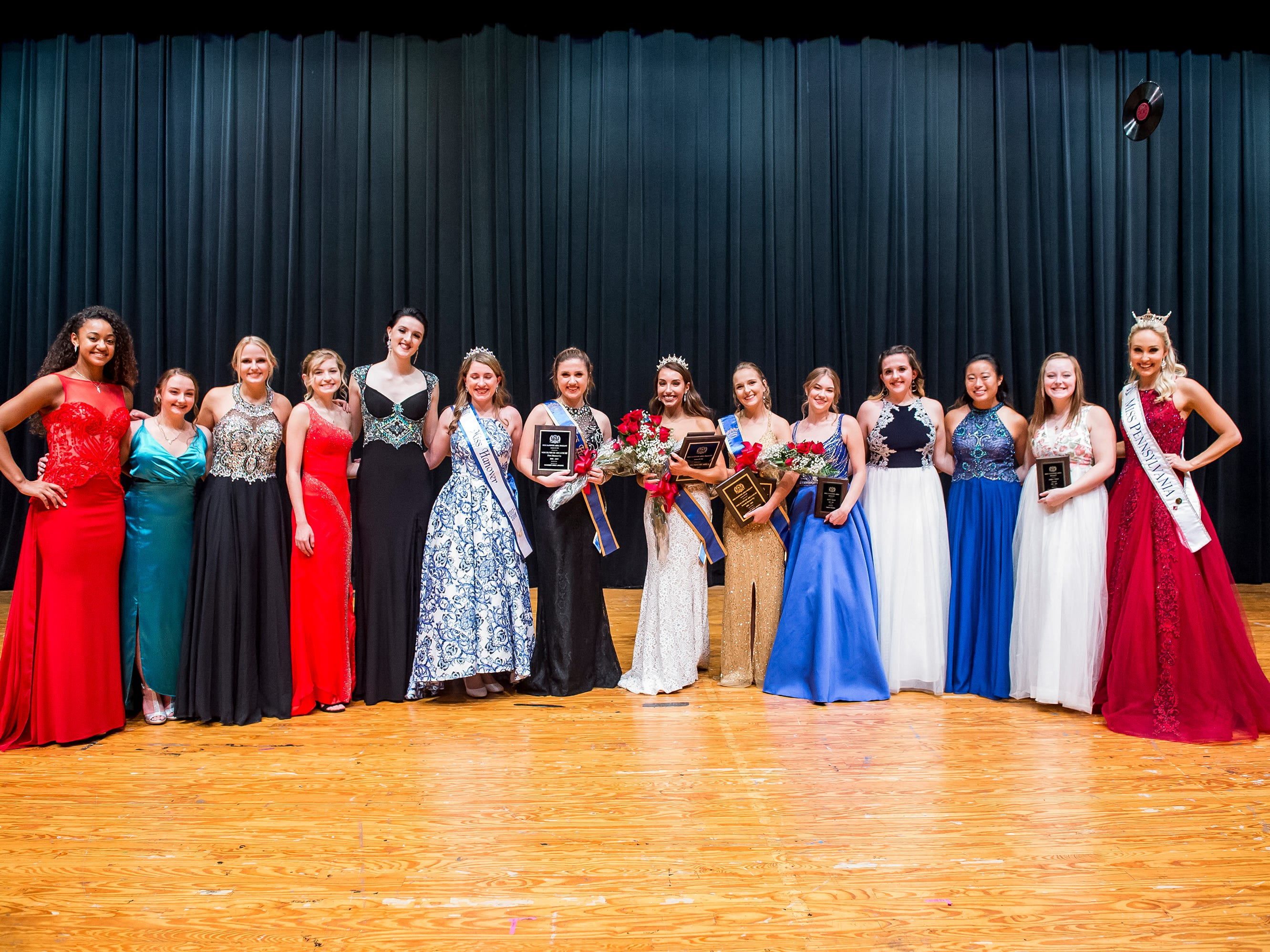 The 12 Miss Hanover Area contestants pose for a photo along with Miss Pennsylvania, Kayla Repasky, and Miss Hanover '17-'18, Marley Bradner, following the 50th Miss Hanover Area pageant at New Oxford High School on Monday, October 22, 2018.