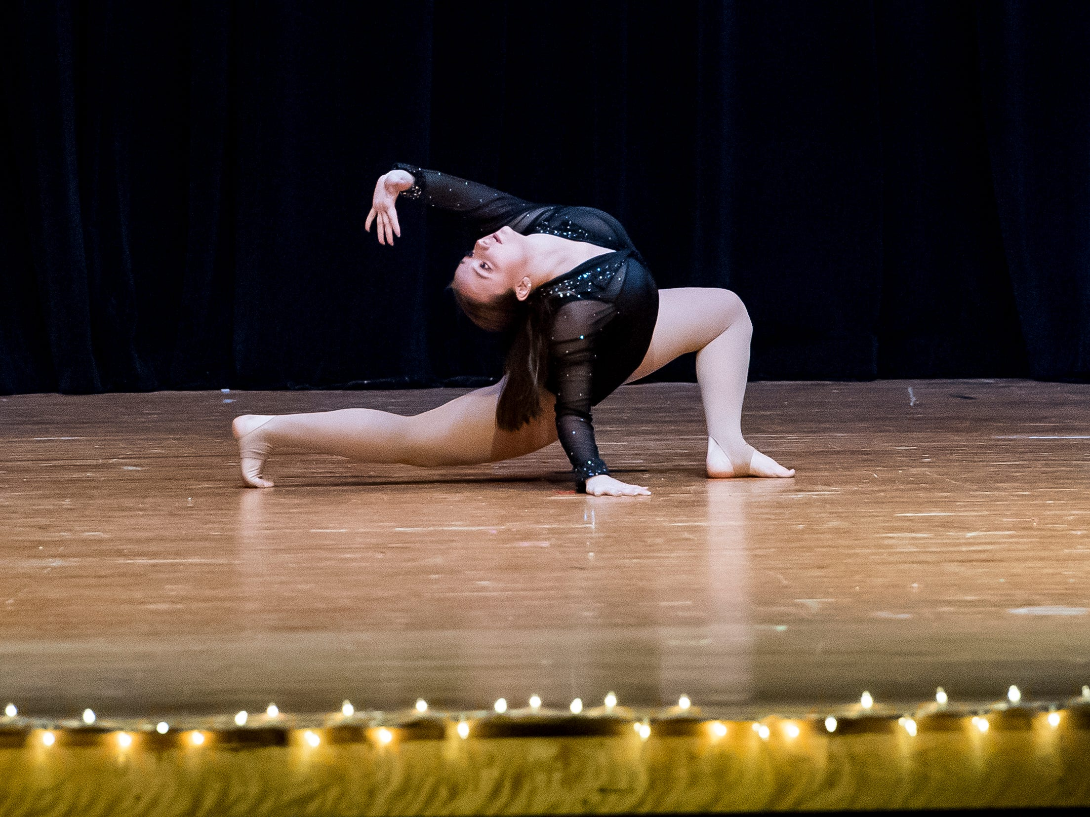 Danielle Ginevra performs a dance routine in the talent competition during the 50th Miss Hanover Area pageant on Monday, October 22, 2018.