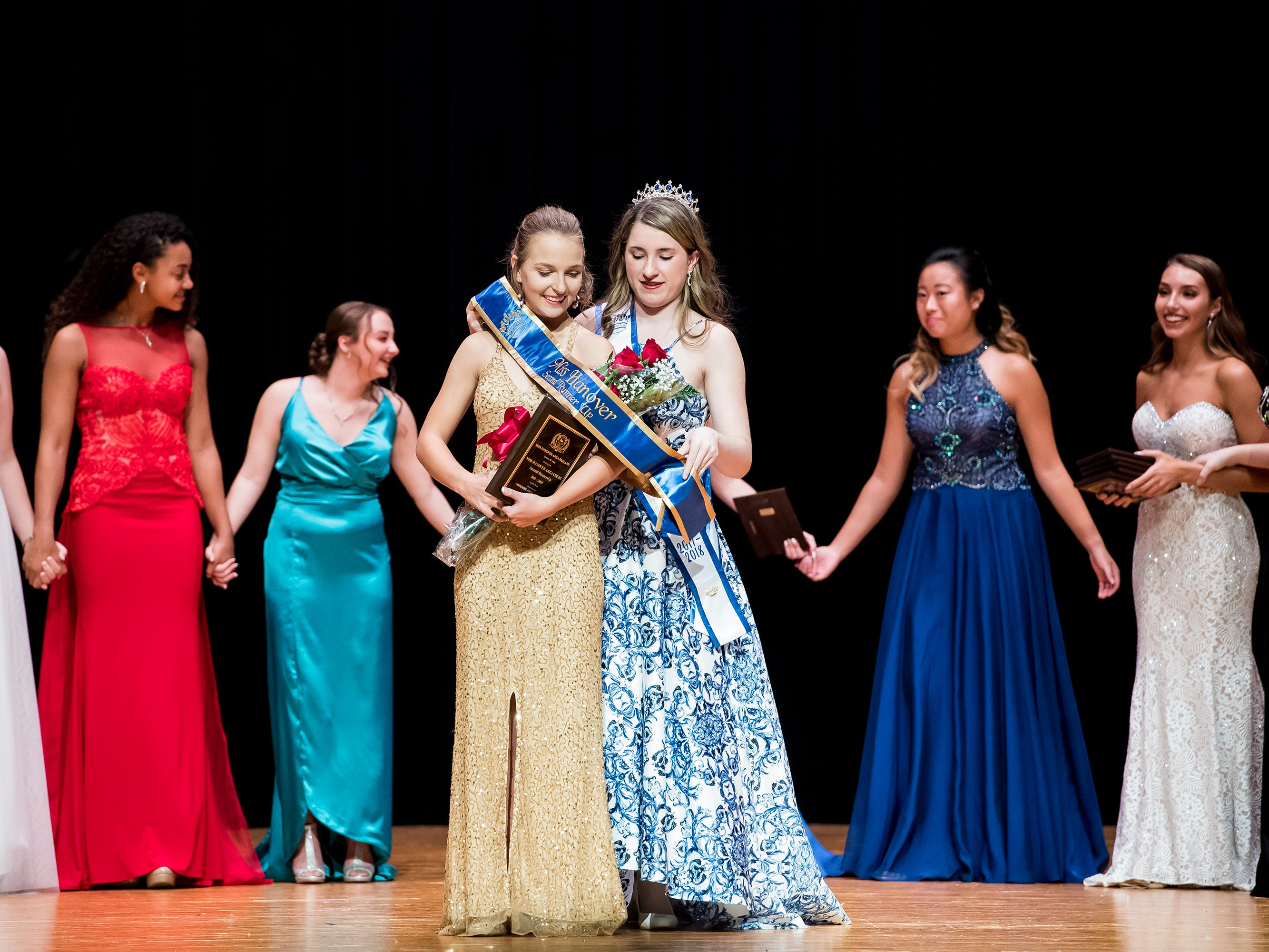Littlestown's Lindsay Boritz is presented with a sash after being named the second runner-up at the 50th Miss Hanover Area pageant on Monday, October 22, 2018.
