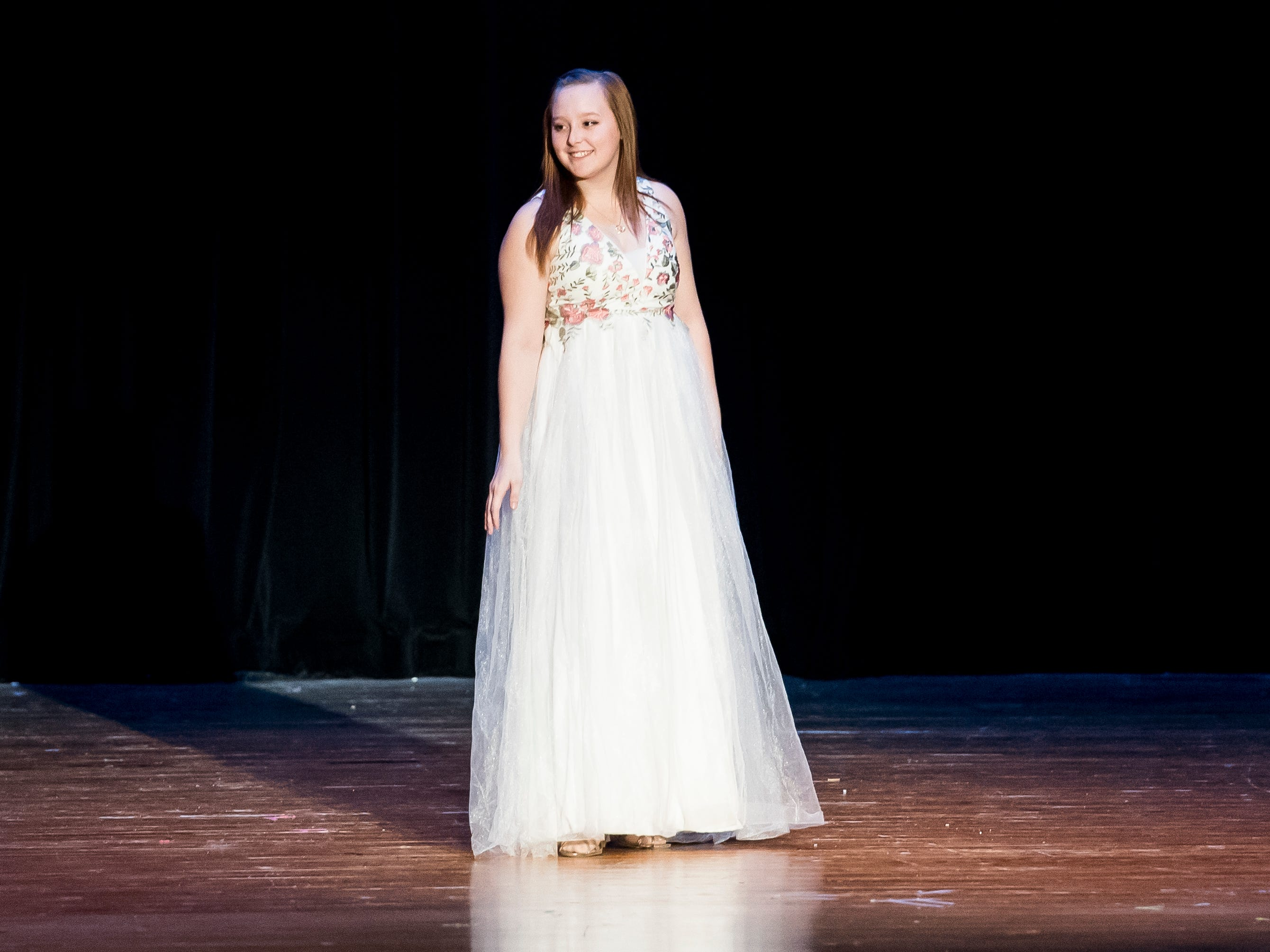 Alissa Wagaman walks on stage during the evening gown competition in the 50th Miss Hanover Area pageant on Monday, October 22, 2018.
