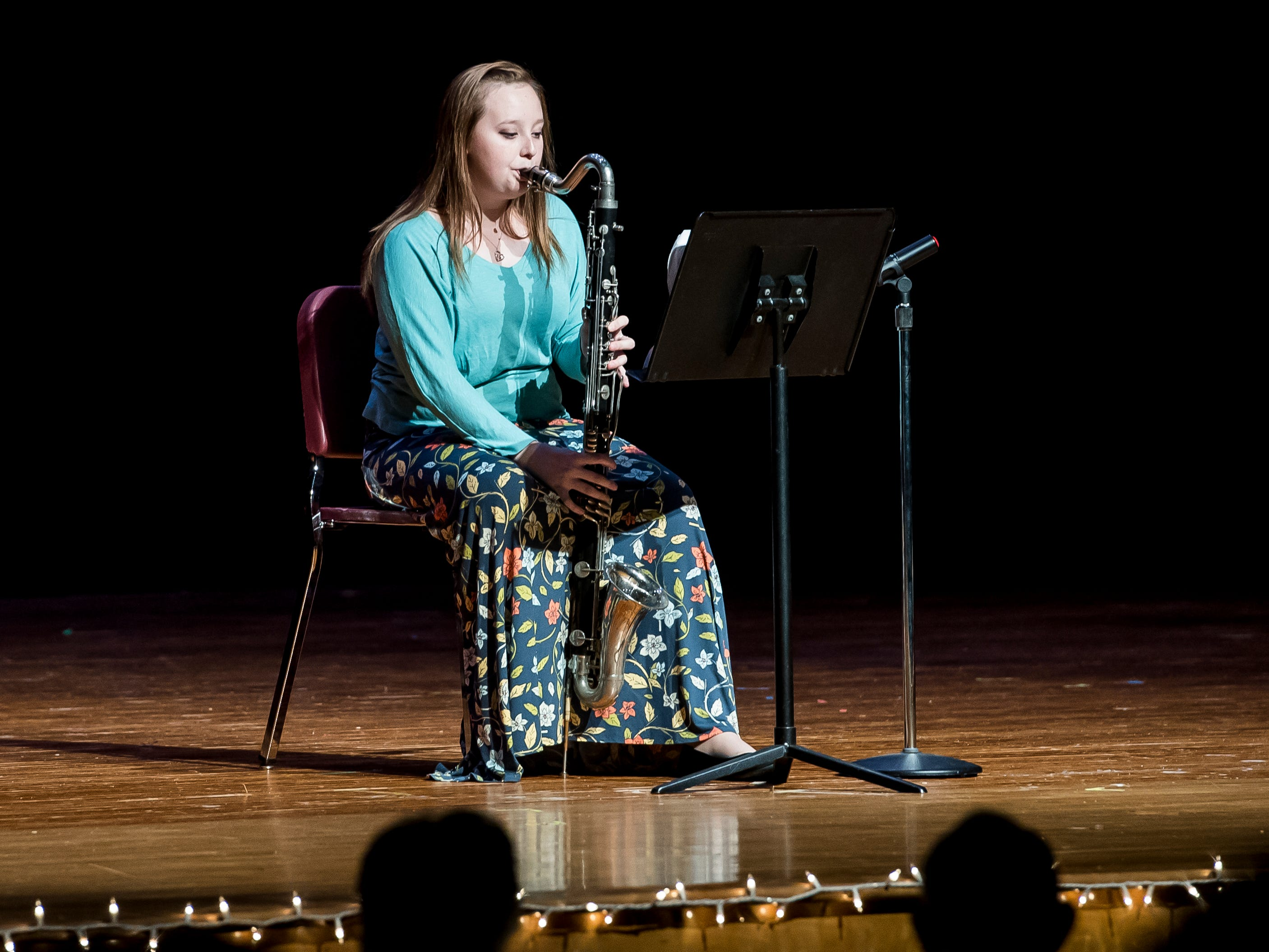 Alissa Wagaman plays the bass clarinet in the talent competition during the 50th Miss Hanover Area pageant on Monday, October 22, 2018.