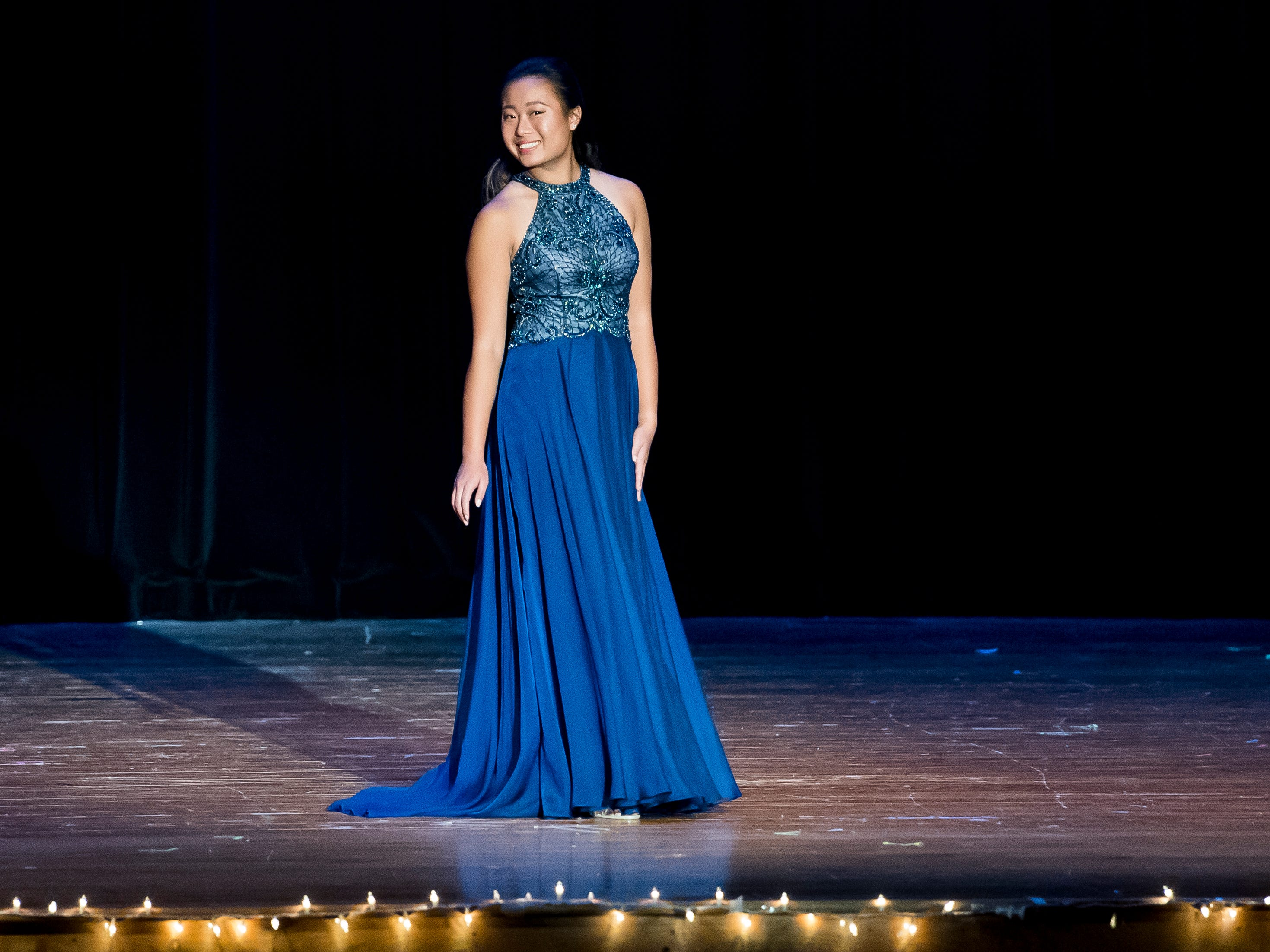 Karen Yang walks on stage during the evening gown competition in the 50th Miss Hanover Area pageant on Monday, October 22, 2018.