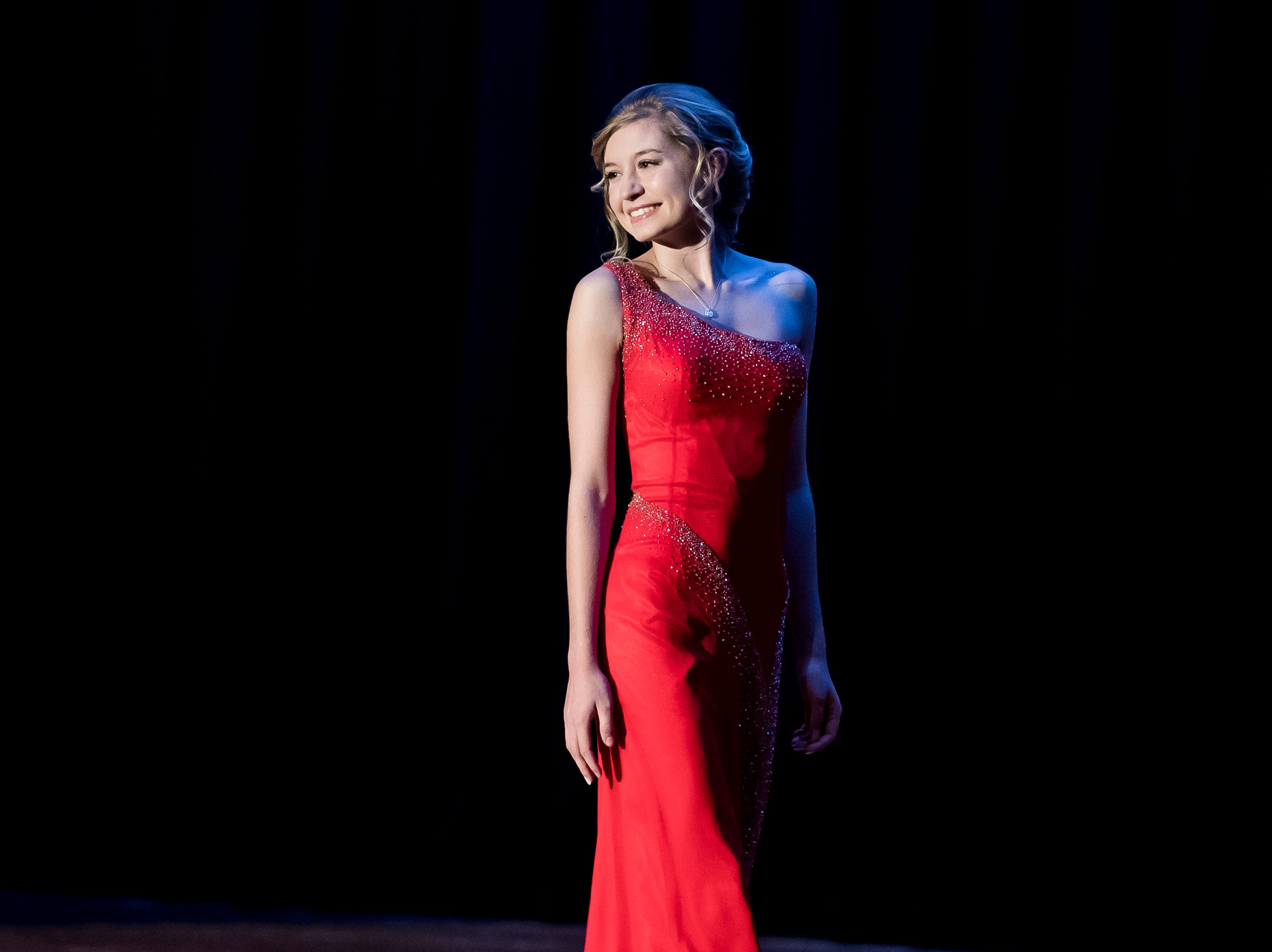 Grace Dickmyer walks on stage during the evening gown competition in the 50th Miss Hanover Area pageant on Monday, October 22, 2018.