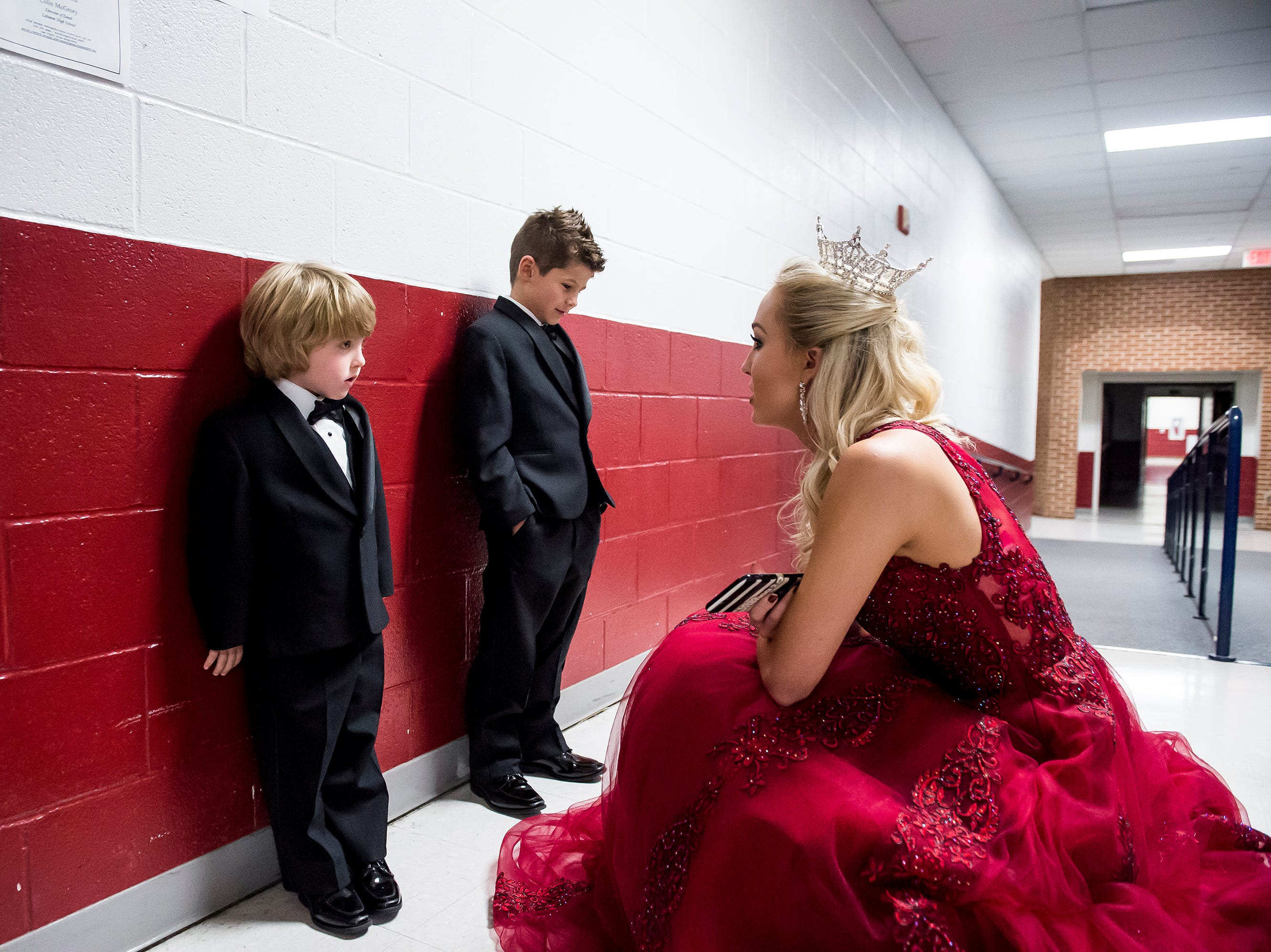 Miss Pennsylvania, Kayla Repasky, talks with Dawson Seigmand, 4, left, and Liam Colvin, 6, during an intermission at the 50th Miss Hanover Area pageant at New Oxford High School on Monday, October 22, 2018.