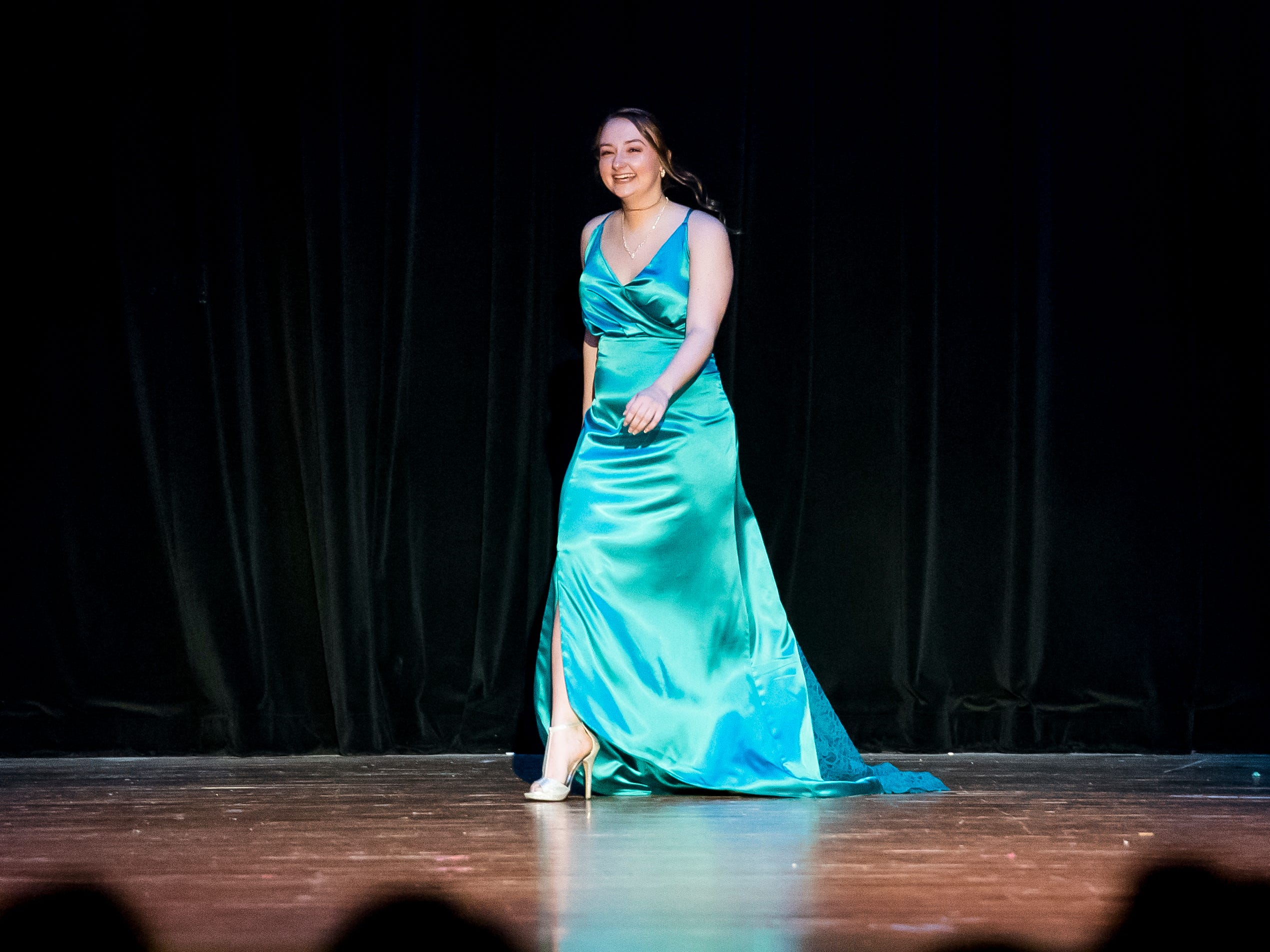 Danielle Ginevra walks on stage during the evening gown competition in the 50th Miss Hanover Area pageant on Monday, October 22, 2018.