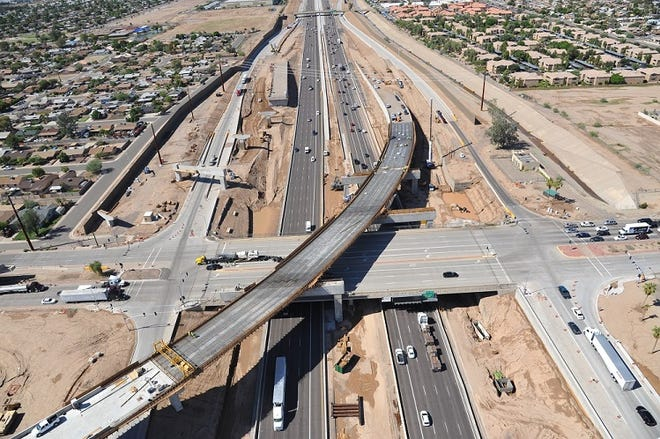 The I-10/Loop 202 interchange under construction at 59th Avenue in the West Valley.