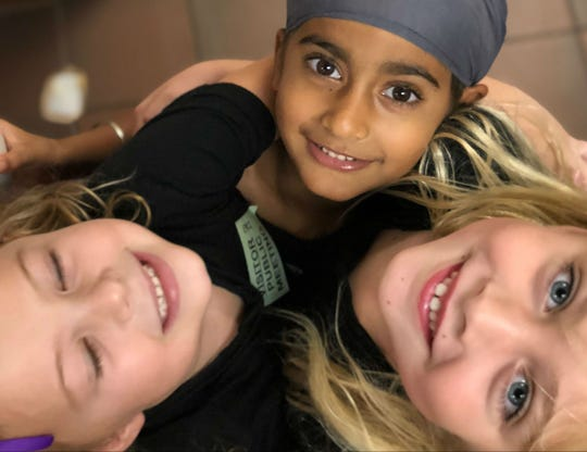 """Six-year-old Anaik Sachdev (center, with friends Scarlett and Charlotte) spoke before the Arizona State Board of Education on Oct. 22, 2018, about the revised science and history standards. Anaik, who is Sikh, asked the board to adopt the revised history and social science standards over schools chief Diane Douglas' Hillsdale proposal, which only covers Judaism, Christianity and Islam. """"I like to learn about people and I want different people to learn about me,"""" he said."""