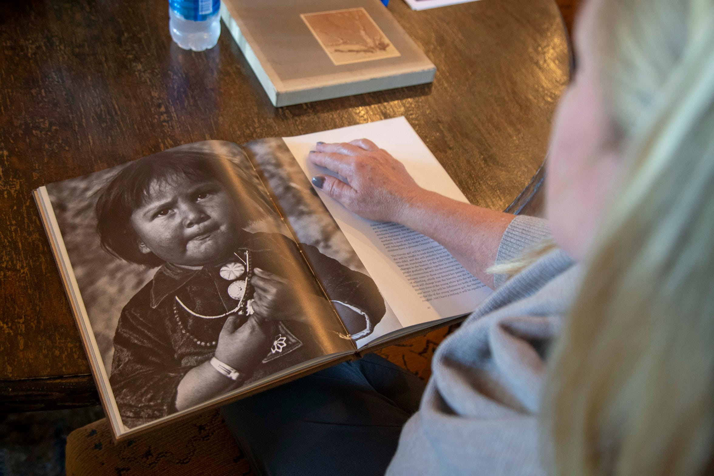 Alison Goldwater shows a photograph of natives taken by her grandfather Barry Goldwater. Alison Goldwater and her family is getting ready to release an archive of photos taken by Barry Goldwater throughout his life and created a library and foundation to honor his legacy.