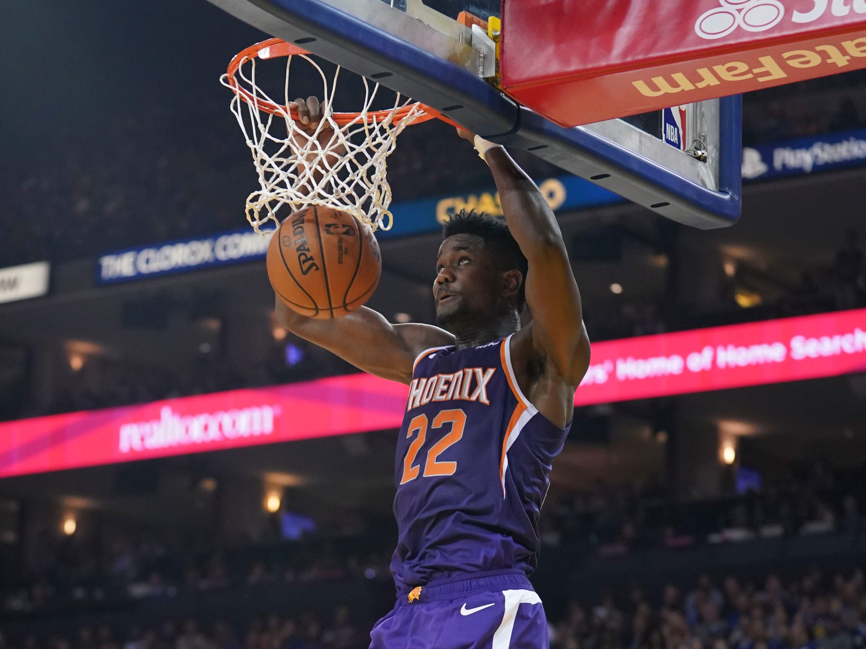October 22, 2018; Oakland, CA, USA; Phoenix Suns center Deandre Ayton (22) dunks the basketball against the Golden State Warriors during the second quarter at Oracle Arena. Mandatory Credit: Kyle Terada-USA TODAY Sports