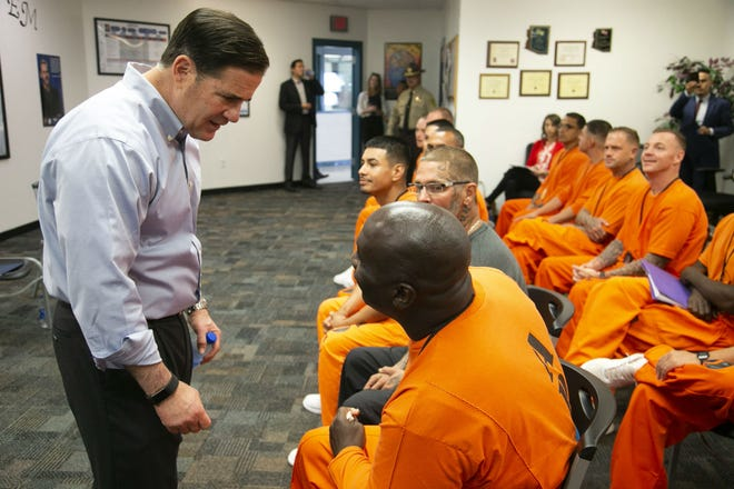 Governor Doug Ducey speaks with inmate Marcus Moore during a tour of the Second Chance Center in the Eagle Point Unit of the Arizona State Prison Complex-Lewis in Buckeye on October 23, 2018. Governor Ducey, Cardinals President Michael Bidwill, Cardinals defensive back Antoine Bethea and defensive lineman Corey Peters toured the Second Chance Center in the prison. The Second Chance Center is working to prepare inmates for their release to find jobs and in other areas to prevent recidivism.