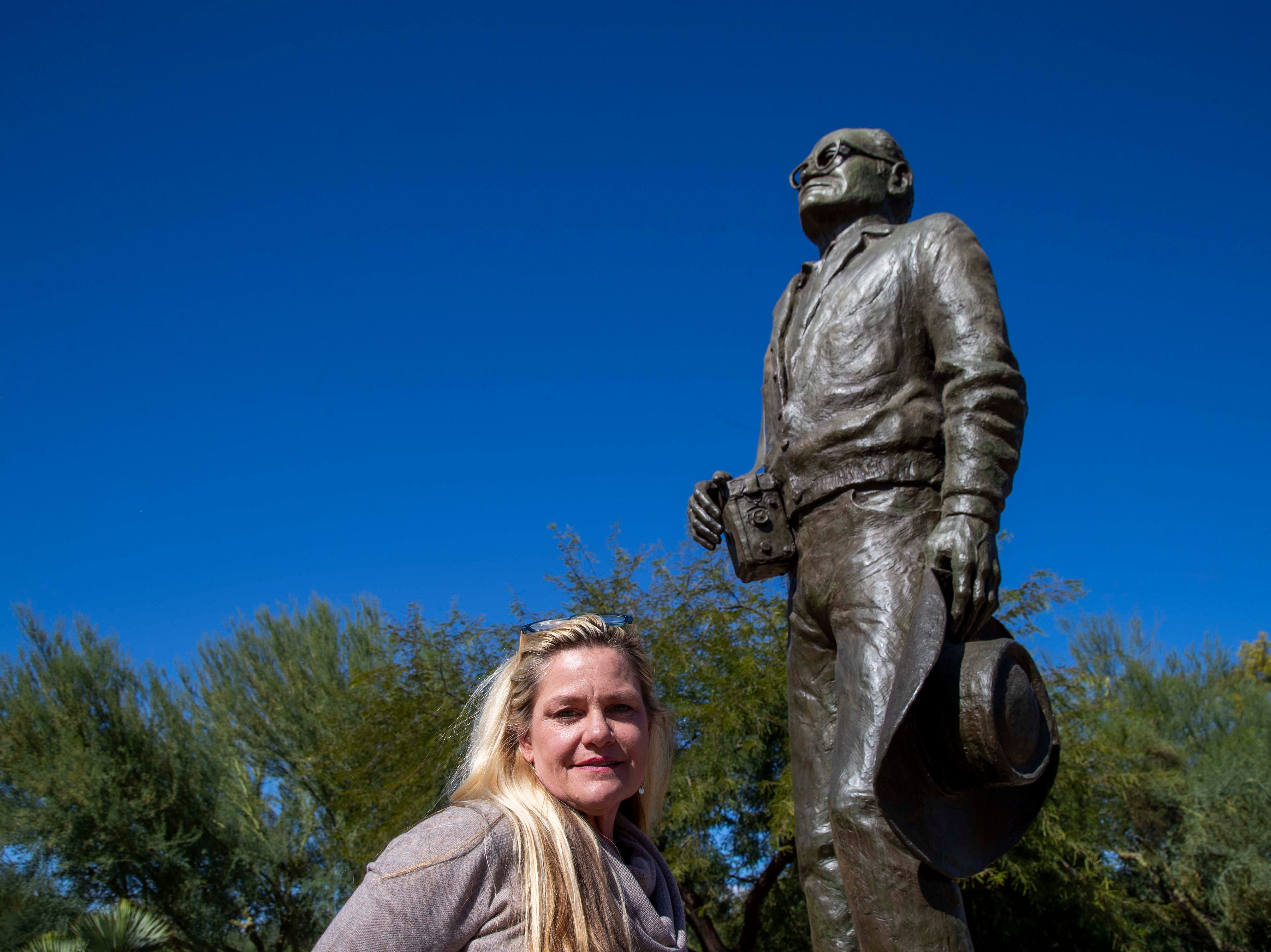 Portrait of Alison Goldwater, a granddaughter of Barry Goldwater stands on front of bronze statue in Paradise Valley, Az.