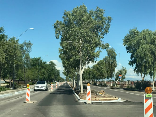 Vehicles navigate construction on Bullard Avenue.