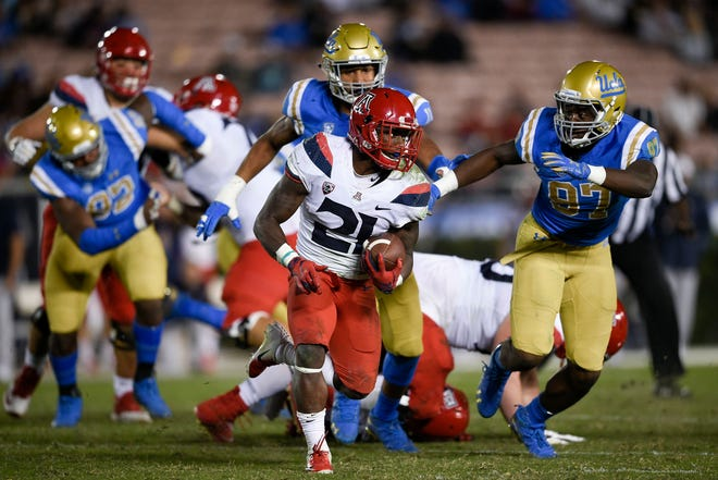 Oct 20, 2018: Arizona Wildcats running back J.J. Taylor (21) runs the ball during the second half against the UCLA Bruins at Rose Bowl.