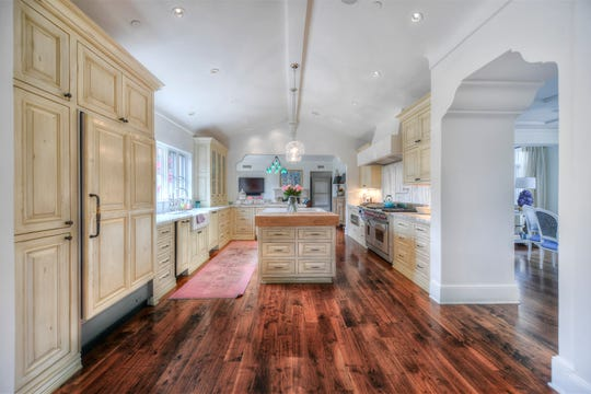 The Arcadia-area house was built in 2005 and features upgrades that include crown molding, custom cabinetry and hardwood flooring.