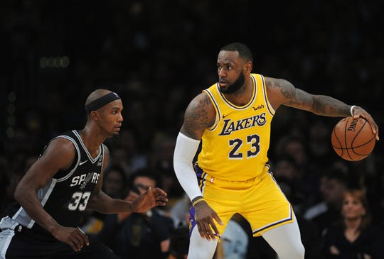 LeBron James had 32 points with 14 assists and eight rebounds in the Lakers' 143-142 loss to the Spurs on Monday at Staples Center.