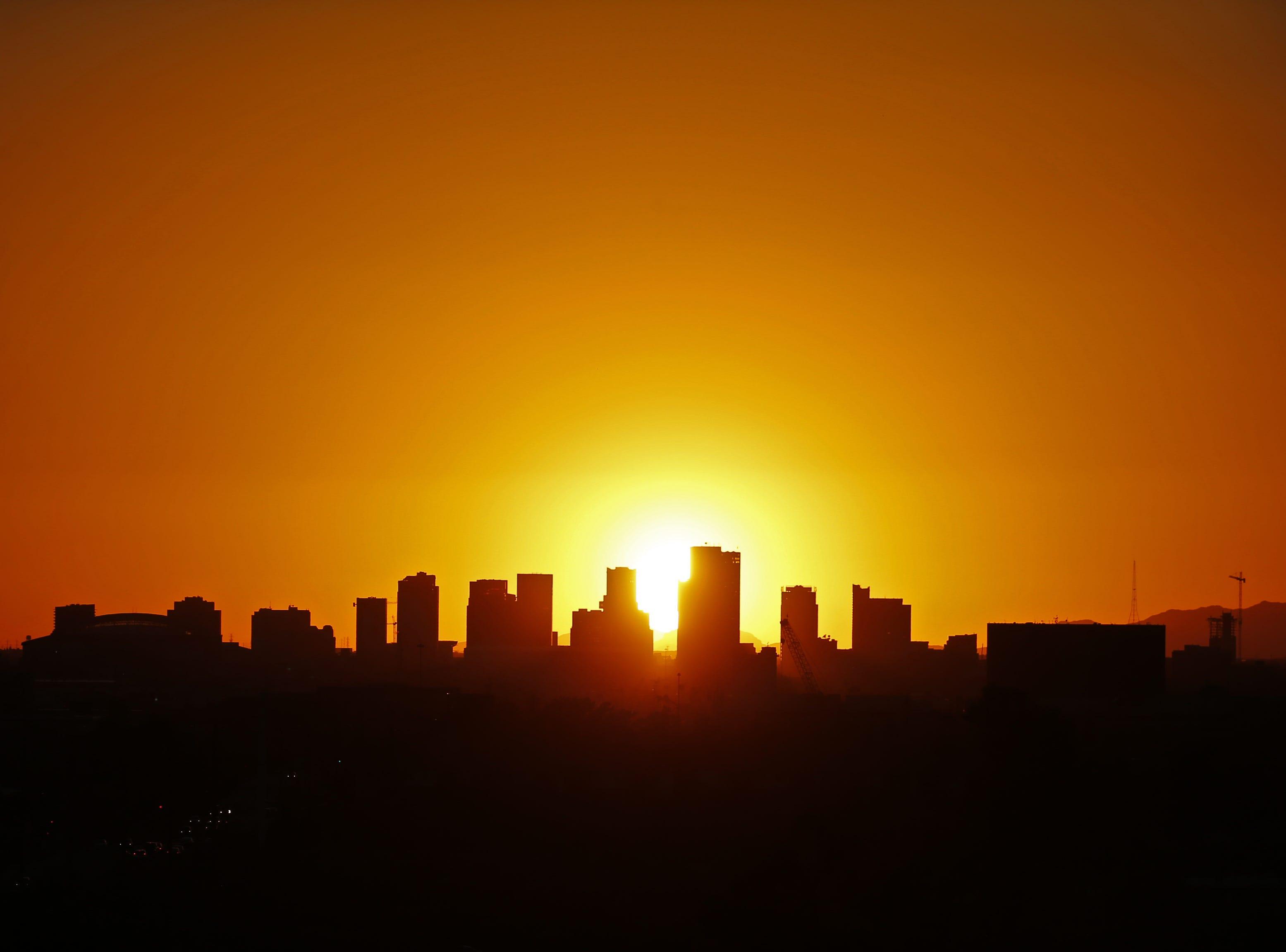 Interest rates climb and metro Phoenix home prices dip