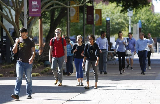 Students walk on ASU's downtown campus in Phoenix on Oct. 22, 2018. Downtown Phoenix has evolved from nearly a ghost town in the 1990s to the vibrant downtown today.