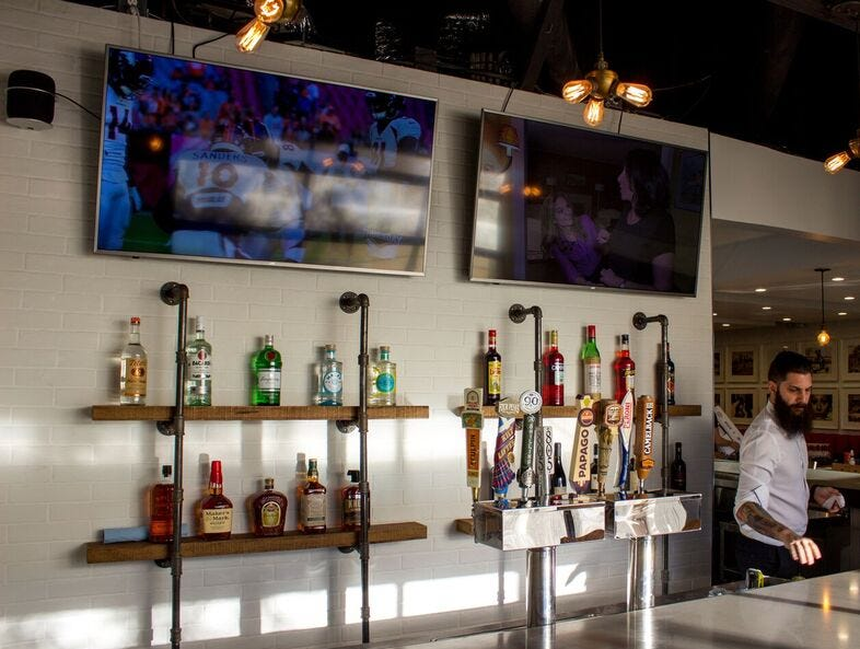 The redesigned bar at Pomo Pizzeria in downtown Phoenix features an industrial look.