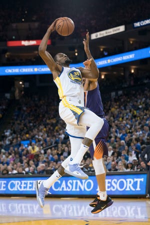 October 22, 2018; Oakland, CA, USA; Golden State Warriors forward Kevin Durant (35) is fouled by Phoenix Suns guard Devin Booker (1) during the third quarter at Oracle Arena. Mandatory Credit: Kyle Terada-USA TODAY Sports