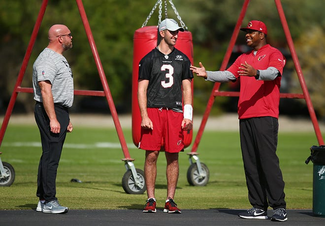 Arizona General Manager Steve Keim, quarterback Josh Rosen and new offensive coordinator Byron Leftwich converse on Oct. 22 at the Cardinals Training Facility.