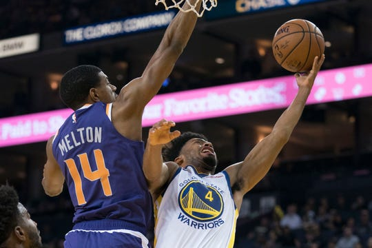 October 22, 2018; Oakland, CA, USA; Golden State Warriors guard Quinn Cook (4) shoots the basketball against Phoenix Suns guard De'Anthony Melton (14) during the fourth quarter at Oracle Arena. Mandatory Credit: Kyle Terada-USA TODAY Sports