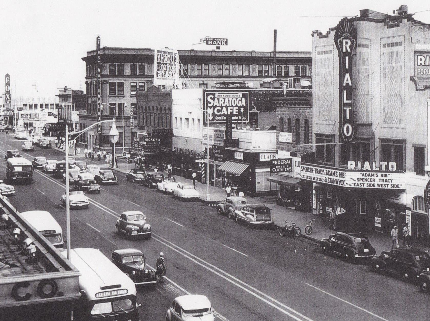 The Fox Theatre (left) was once the grandest movie theater in Phoenix. It was torn down in 1978 to make way for Phoenix's downtown bus terminal.