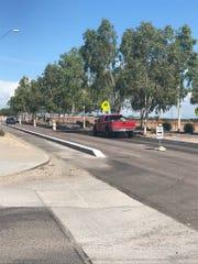 Vehicles navigate construction on Bullard Avenue near Windrose Drive.